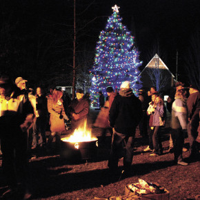 Revellers enjoy the fire pit, while kids wait for Santa in 2009.