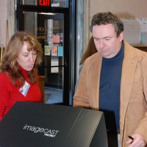 District One election worker Kathy Terrio shows voter Steven Lynch how to cast his ballot in the new voting machines Nov. 2. No issues were reported with voting machines in Districts One, Four or Five.