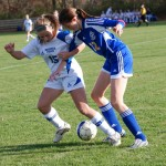 Meghan O'Brien vies for the ball.