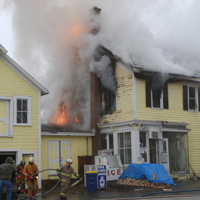 Flames begin to emerge from the thick smoke as the Bedlam Corners General Store burns Friday, Dec. 10 about 9:45 a.m.