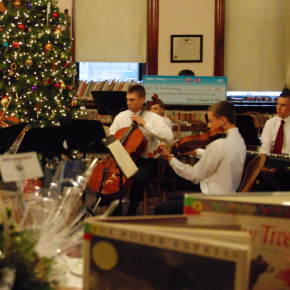 Local musicians perform at the Pember Library and Museum annual Christmas open house Sunday Dec. 12. Members included Rachel Aubrey, Isaac Beckler, Samuel, Phillip, Hannah and Jonathan Kilpatrick led by Brian Kilpatrick.