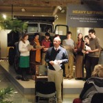Professor Jim Casarino gives and introduction to a selection members of the Green Mountain College Cantorion performed at the Slate Valley Museum Sunday Dec. 12 as a part of the annual open house.