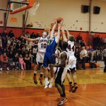 John Manchester hauls down a rebound against Corinth in a 53-42 Granville win Dec. 23.