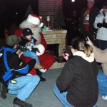 One popular kid. As the 'paparazzi' gather around, 16-month-old Kolton Spaulding from Whitehall gets a moment with Santa Claus. Dad Matthew Spaulding, mom Alyson and Nana Cheryl Spaulding pause to catch a snap shot. Dec. 3, 2010