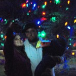 Making a memory. Tammy Thomas and Brad Boyle take a picture with thier 1-year-old son Jeremiah next to the village Christmas tree. Dec. 3, 2010.