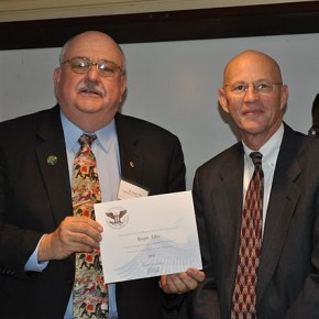 Roger Ellis receives a Presidential Volunteer Service Award from Gregory Gottlieb, deputy assistant administrator for the Bureau of Food Security.