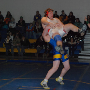 Eric Hastings (285) throws Alex Deluso just before winning the match early in the second period. The win was Hastings' 100th, he has only one loss on the season by one point.