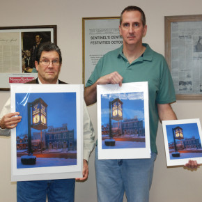 Photographer Alan Nyiri with clock restorer John Freed dispalying the three sizes of print available for purchase.