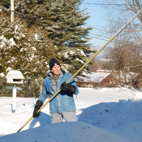 Don DeKalb finishes clearing off the roof of his residence on Beecher Road Thursday afternoon. DeKalb said he'd spent most of the morning on the nearly two feet of snow on top of the house.