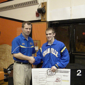Horde head coach recognizes his latest 100-win wrestler 130-pounder Brendan Miller.