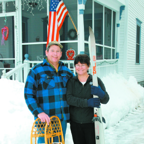 Dave and Andrea Guest outside thier Park Avenue home with snowshoes and skiis. He uses his snowshoes to help pack down a cross country ski loop at the Mettowee River Park for his wife of 25 years.