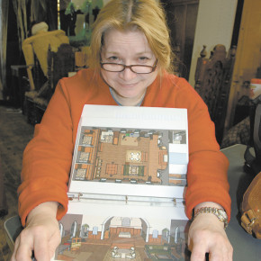 Gisele 'Gigi' Zeitler recently purchased the Our Lady of Mount Carmel church on Dayton Hill Road. Here she displays some of the plans she has for renovating the interior space. Zeitler said the 'respectful' redesign of the interior will allow members of the congregation to see reminders of the church in the new layout.