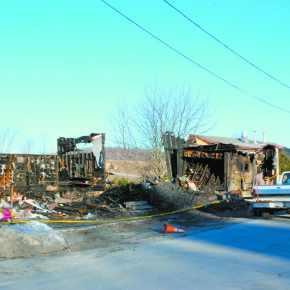 Two men speak near the ruins of Dutchie's General Store in West Pawlet, Monday morning. A fire in the early morning hours of Saturday destroyed the store and claimed the life on one man. Fire officials say the blaze is not suspicious.