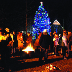 Revellers gather around the fire ring on a chilly Hometown Holiday evening. Despite cold temps, the event is well attended each year as Santa comes to town to light the Granville Christmas tree.