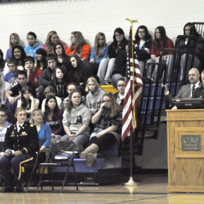 Ssgt. Steve Palmer introduces Capt Ashleigh Davidson at the Adopt-a-Soldier Assembly Nov. 17 at GHS. More than 200 boxes were sent from the school to troops stationed overseas.