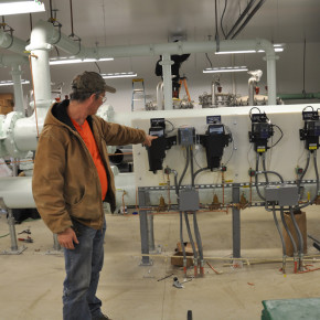 Dan Williams indicates some of the water treatment plant's features.