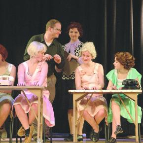 Producer Chris Palmer gives cast members some instructions during rehearsals on Monday evening.