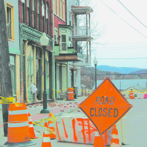 "A portion of Main Street will remain closed until a building that has been deemed ""structurally unsafe"" is remedied. There is currently no timetable for its reopening."
