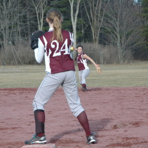 Shortstop Carli Varmette makes a throw to first baseman Ariel Ayers.