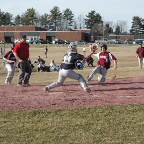 Justing Hoagland attempts to steal home in the third inning of Monday's game against Lake George. He was called out on the play.