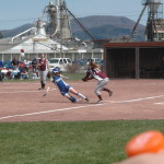 Brooke Paddock attempts to tag out a Granville base runner. The runner slid in safely.