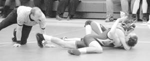 Board approves merger of wrestling teams