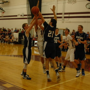 Dan St. Clair draws a foul as he goes up for a layup