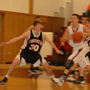 Evan St. Claire is guarded by Brandon Drollette, as he drives the lane
