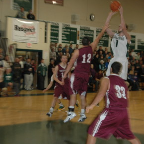 Justin Hoagland contends Justin Carruthers' jump shot