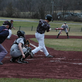 Derek Thomas rips a basehit diown the left field line