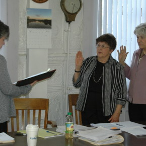 Trustees Pat Norton (l) and Marge Mohn are sworn in by Village Clerk Stephanie LaChapelle