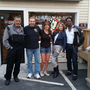 From left, Laurence Fishburne, What's Up Dawg's owners Vinnie and Julie Covina, Lauren Hutton and Harold Perrineau last week at an unexpected visit to the Granville hot dog hot spot.