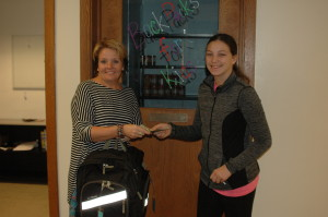 Seventh-grader donates to backpack program