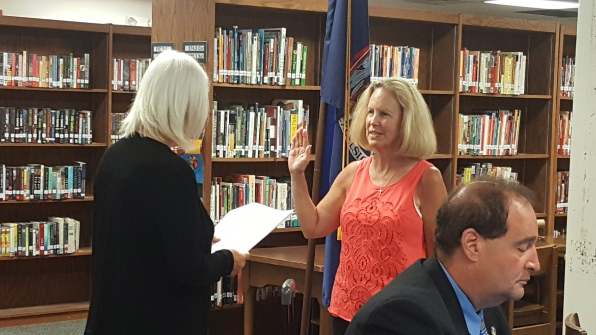 School Board President Audrey Hicks was reelected Monday, July 11. She is pictured here being sworn in at the board's reorganizational meeting.