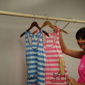 Sondra Smith displays some of the dance attire that will be sold in the new dance shop.