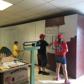 Volunteers from the Lowe's in Queensbury paint the interior of the Whitehall Rec Center Monday.