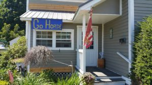 A 'Go Horde' sign is displayed outside Coach Mario Torres' home in the village.