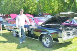 Ward Woodruff poses with his '67 Dodge Polara.