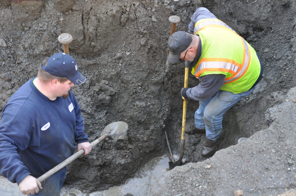Granville Highway Department workers Nick Loomis (left) and John Harney dug up a portion of Route 12A in Truthville Monday to fix a water leak.