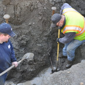 Workers repair a water line break in the North Granville water district.
