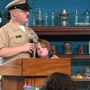 Senior Chief Petty Officer Daniel Brouillard and child
