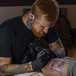 Tattoo artist comfortable in his skin
