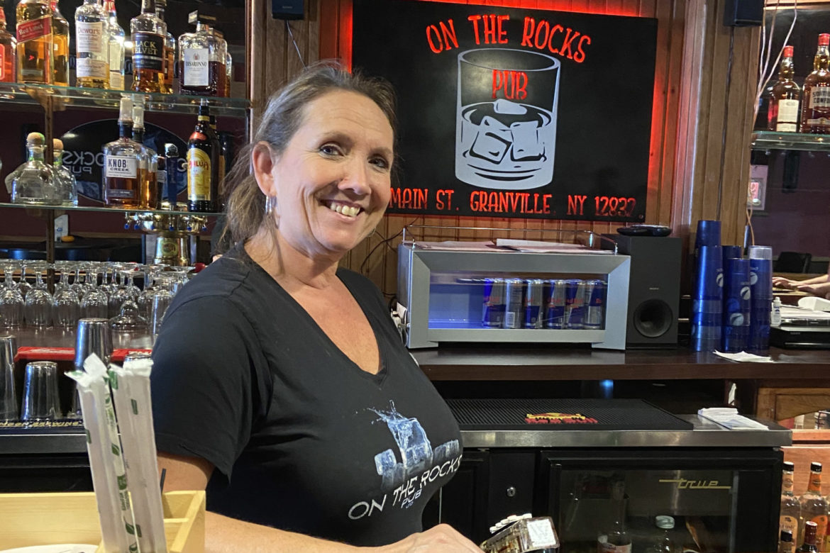 Owner Vicky Hale poses for the camera behind the bar.