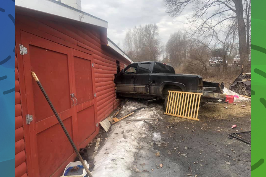 Truck strikes house, driver hurt