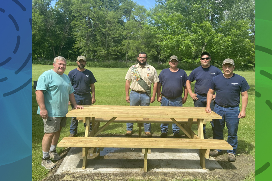 Theo Mann, 17, builds picnic tables